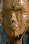 extreme close up of a with plastic tape covered display mannequin head