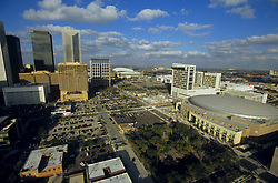 Aerial view of Houston, Texas showing the Toyota Center, Hilton Hotel, and Minute Maid Park.