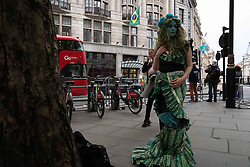 May 1, 2019 - London, Greater London, United Kingdom - An Extinction Rebellion protester seen wearing a costume during the campaign..The protest was to show solidarity with the Amazon rainforest.  Vivienne Westwood was heard pledging her support for the Extinction Rebellion campaign and declaring to shut her shop if the Extinction Rebellion protestors planned to shut down London again. (Credit Image: © Lexie Harrison-Cripps/SOPA Images via ZUMA Wire)