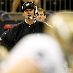 August 12, 2011; New Orleans, LA, USA; San Francisco 49ers head coach Jim Harbaugh watches from the sideline during the second half of a preseason game against the New Orleans Saints at the Louisiana Superdome. The New Orleans Saints defeated the San Francisco 49ers Mandatory Credit: Derick E. Hingle