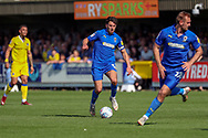 AFC Wimbledon defender Will Nightingale (5) dribbling and about to pass to AFC Wimbledon striker James Hanson (18) during the EFL Sky Bet League 1 match between AFC Wimbledon and Bristol Rovers at the Cherry Red Records Stadium, Kingston, England on 19 April 2019.
