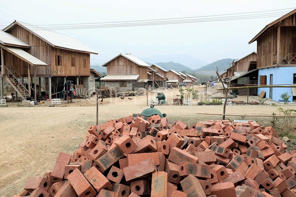 A pile of bricks in the recently relocated village of Ban Thong Chalern in Sayaboury province, Lao PDR. Ban Thong Chalern consists of three villages (Khmu and Lao Loum) which have been joined together and relocated due to the ongoing construction of the Xayaburi Dam on the Lower Mekong river in Northern Laos.