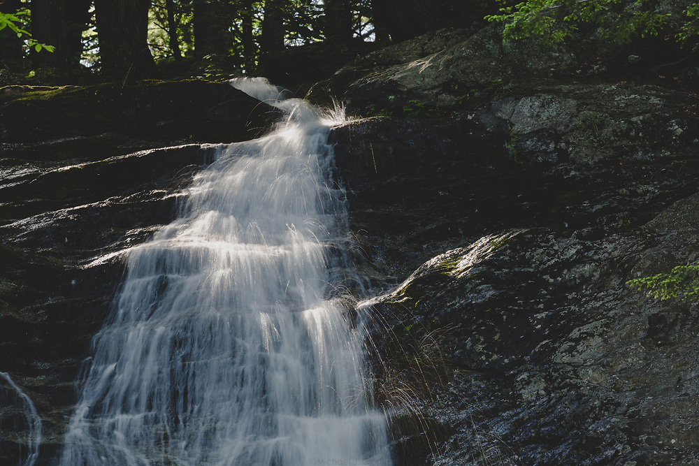 The top section of Tannery Falls cascading on a warm summer afternoon in the remote forests of Massachusetts.