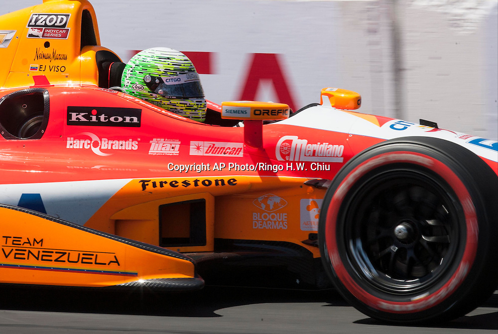 E.J. Viso (5) of Venezuela races during the Indy Car Series' Grand Prix of Long Beach auto race, Sunday, April 21, 2013, in Long Beach, Calif.  (AP Photo/Ringo H.W. Chiu)