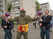 BURRYMAN ANDREW TAYLOR: SUPPORTED BY ANDREW FINDLATER; DUNCAN THOMPSON, Burry Man, Queensferry. 12 August 2016 Alocal man is covered from head to ankles in burrs and paraded a 7 mile route around the town visiting the community.<br /> Tradition holds that he will bring good luck to the town if they give him whisky and money,  This year he wore a Scottish flag.