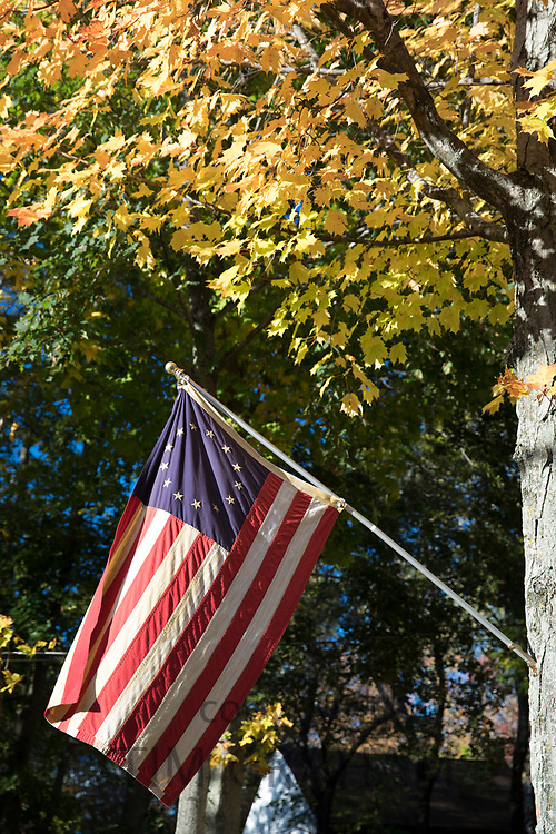 Stars and Stripes flag at a home in Wolfeboro in New Hampshire, New England, USA