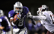 MANHATTAN, KS - OCTOBER 17:  Running back Daniel Thomas #8 of the Kansas State Wildcats rushes past defender Eddie Brown #19 of the Texas A&M Aggies for a first down run in the second quarter on October 17, 2009 at Bill Snyder Family Stadium in Manhattan, Kansas.  (Photo by Peter G. Aiken/Getty Images)