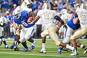 Dec 1, 2012; Tulsa, Ok, USA; Tulsa Hurricanes tailback Alex Singleton (8) runs the ball past University of Central Florida Knights defensive back Brandon Alexander (37) during a game at Skelly Field at H.A. Chapman Stadium. Tulsa defeated UCF 33-27 in overtime to win the CUSA Championship. Mandatory Credit: Beth Hall-USA TODAY Sports