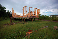 27 August 2014. Lower 9th Ward, New Orleans, Louisiana.<br /> Hurricane Katrina 9 years later. One of the many partially rebuilt properties dotting the landscape as the area continues to struggle with recovery from Hurricane Katrina.<br /> Photo; Charlie Varley/varleypix.com