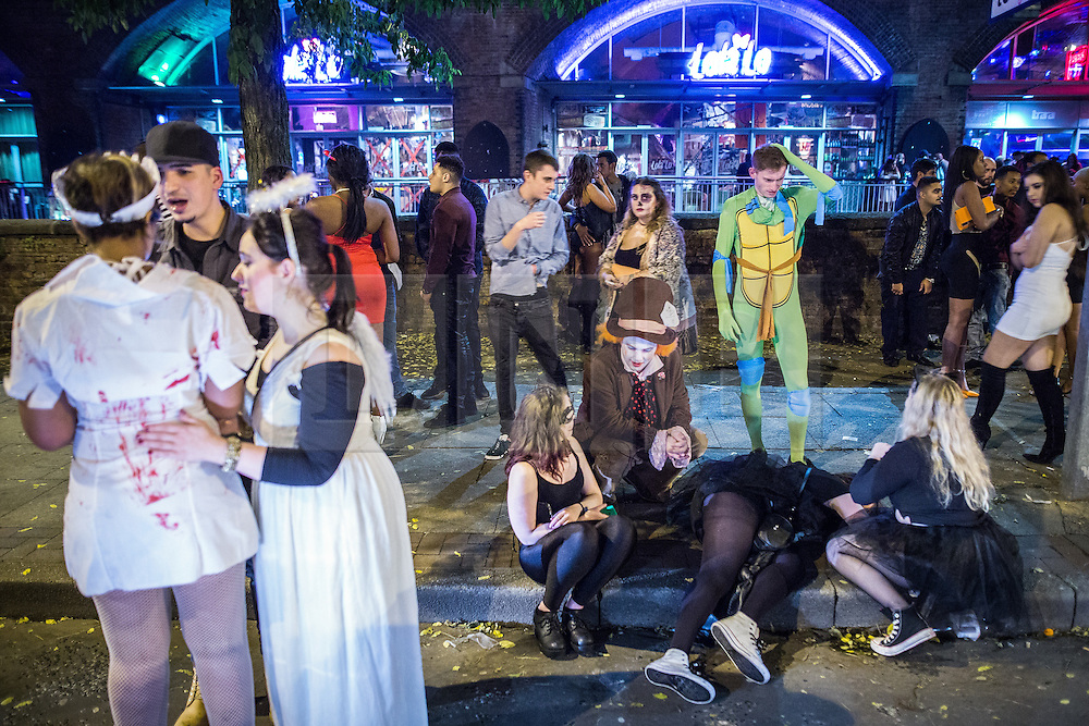 © Licensed to London News Pictures . 01/11/2015 . Manchester , UK . People on Deansgate Locks . Halloween revellers , wearing make up and costumes , out and about in Manchester City Centre . Photo credit : Joel Goodman/LNP
