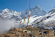 Machhapuchhre (or Machhapuchhare), Fish Tail Mountain (on right; 22,943 feet / 6997 meters elevation), is a sacred peak, illegal to climb, in the Annapurna Range of Nepal. Annapurna South Base Camp (ABC, at 13,550 feet elevation) is in the Annapurna Sanctuary.