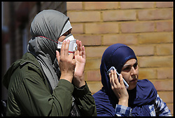 June 14, 2017 - London, London, United Kingdom - Image ©Licensed to i-Images Picture Agency. 14/06/2017. London, United Kingdom. Grenfell Tower Fire. ..Women with face mask. Smoke billows from Grenfell Tower after a fire engulfed the block in west London. The massive fire ripped through the 24-storey apartment block  in the early hours of Wednesday, trapping residents inside as 200 firefighters battled the blaze. Police and fire services attempted to evacuate the concrete block and said 'a number of people are being treated for a range of injuries', including at least two for smoke inhalation...Picture by Dinendra Haria / i-Images (Credit Image: © Dinendra Haria/i-Images via ZUMA Press)