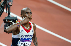 © Licensed to London News Pictures. 06/06/2012. London,Britain.Mo Farah celebrates after he won the gold medal in the Men's 10000m, at the Olympic Stadium, in London, during the London 2012 Olympic Games.  Photo credit : Bogdan Maran/LNP/BPA