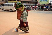 Mar. 13, 2009 -- VANG VIENG, LAOS: A Hmong woman brings produce to the Hmong market in Phou Khoun, Laos. Phou Khoun is about halfway between Vang Vieng and Luang Prabang.  Photo by Jack Kurtz