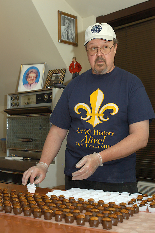 Ron Harris producing Happy Balls, Friday, April 21, 2006, the hand-dipped bourbon ball product he makes with his wife Jane Harris which they distribute from their victorian mansion in Louisville, Ky. ..Photo by Brian  Bohannon , Freelance.