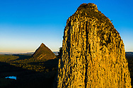 Aerial view of Mt Coonowrin (foreground), and Mt Beerwah,  Glasshouse Mountains, Sunshine Coast, Queensland, Australia