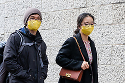 © Licensed to London News Pictures. 14/03/2020. London, UK. Tourists wearing medical masks walk near Tower Bridge this afternoon. The coronavirus is continuing to spread across Europe and the UK and today Spain is reportedly in lockdown for all non essential travel. Photo credit: Vickie Flores/LNP