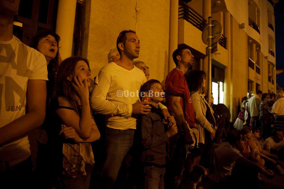 people watching Bastille day fireworks Carcasonne