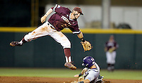 TCU's Cam Warner (4) steals second base as Texas A&M's Austin Homan (25) catches a late throw during the 3rd inning of a NCAA college baseball super regional tournament game, Friday, June 10, 2016, in College Station, Texas. (AP Photo/Sam Craft)