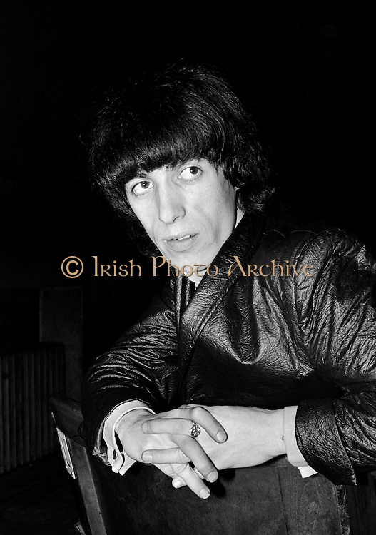 The Rolling Stones Charlie is my Darling - Ireland 1965 -..Bill Wyman at The Rolling Stones press conference at the Adelphi Theatre, Middle Abbey Street, Dublin. This was the band's first Irish tour of 1965....07/01/1965.01/07/1965.07 January 1965..The Rolling Stones Charlie is my Darling - Ireland 1965.Out November 2nd from ABKCO.Super Deluxe Box Set/Blu-ray and DVD Details Revealed. .ABKCO Films is proud to join in the celebration of the Rolling Stones 50th Anniversary by announcing exclusive details of the release of the legendary, but never before officially released film, The Rolling Stones Charlie is my Darling - Ireland 1965.  The film marked the cinematic debut of the band, and will be released in Super Deluxe Box Set, Blu-ray and DVD configurations on November 2nd (5th in UK & 6th in North America).. .The Rolling Stones Charlie is my Darling - Ireland 1965 was shot on a quick weekend tour of Ireland just weeks after ?(I Can't Get No) Satisfaction? hit # 1 on the charts and became the international anthem for an entire generation.  Charlie is my Darling is an intimate, behind-the-scenes diary of life on the road with the young Rolling Stones featuring the first professionally filmed concert performances of the band's long and storied touring career, documenting the early frenzy of their fans and the riots their live performances incited.. .Charlie is my Darling showcases dramatic concert footage - including electrifying performances of ?The Last Time,? ?Time Is On My Side? and the first ever concert performance of the Stones counterculture classic, ?(I Can't Get No) Satisfaction.?  Candid, off-the-cuff interviews are juxtaposed with revealing, comical scenes of the band goofing around with each other. It's also an insider's glimpse into the band's developing musical style by blending blues, R&B and rock-n-roll riffs, and the film captures the spark about to combust into The Greatest Rock and Roll Band in the World.. .The 1965 version of Charlie is my Darling