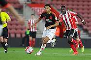 Manchester United U21 Devonte Redmond beats Southampton Olufela Olomola during the Barclays U21 Premier League match between U21 Southampton and U21 Manchester United at the St Mary's Stadium, Southampton, England on 25 April 2016. Photo by Phil Duncan.