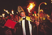 Europe, England, Sussex. English Carnival Bonfire Season. They commemorate the attempted destruction of the Houses of Parliment by Guy Fawkes on Nov 5th 'The Gunpowder Plot'. Also the killing of Protestant martyrs by the Catholics, Pagan rites, the world wars and various other historical events. Three months of nightime festivities where local people march through the streets with flaming torches disguised in fancy dress. Photograph © Nigel Dickinson