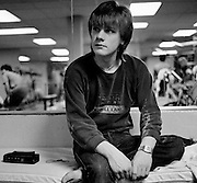 Photo of U2 - Larry Mullen back at the hotel Chicago USA  1982