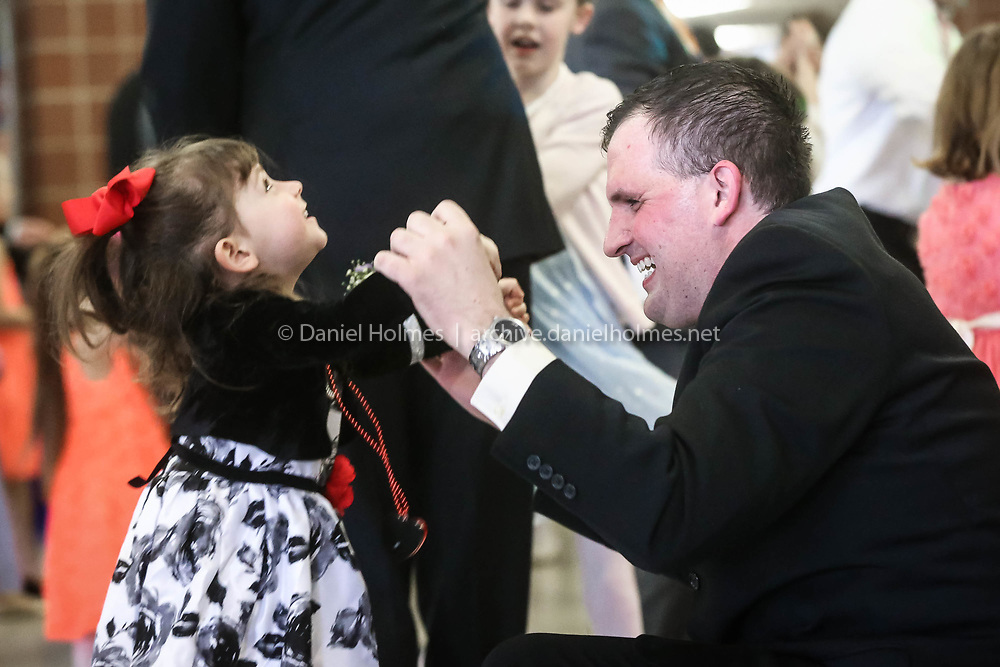 (3/26/17, MEDWAY, MA) Charlotte Haberman, 3, of Medway, dances with her dad Erich during the annual Medway Lions Club Father-Daughter Dance at Medway High School in Medway on Sunday. [Daily News and Wicked Local Photo/Dan Holmes]