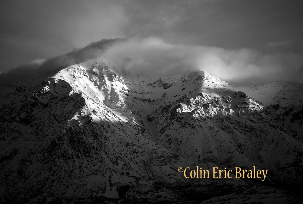 I winter sun shines on the western face along the snow-covered Wasatch mountain range in Utah. Colin Braley/Photo