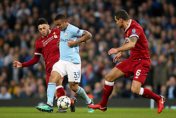 Manchester City's Gabriel Jesus (centre) battles for the ball with Liverpool's Alex Oxlade-Chamberlain (left) and Dejan Lovren