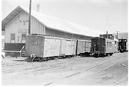 """D&RGW Durango freight house on west side of tracks, between 7th and 8th Streets.  Usual caboose storage.<br /> D&RGW  Durango, CO  Taken by Francis, C.<br /> In book """"Durango: Always a Railroad Town (1st ed.)"""" page 64"""