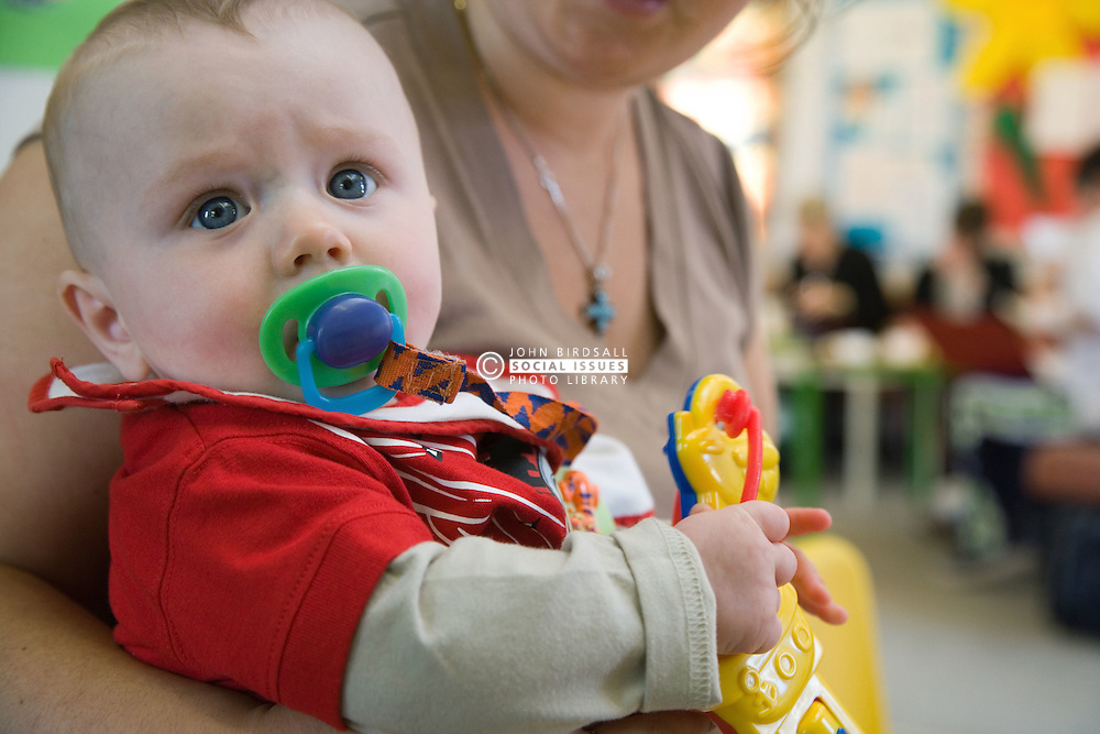 Baby in creche at adult education centre,