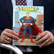 Lima resident Gary Kill holds a Trump-themed coloring book that he got signed by President Donald J. Trump at Lima Allen County Airport in Lima, Ohio, on Wednesday, March 20, 2019. THE BLADE/KURT STEISS