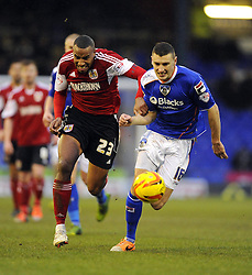 Bristol City's Tyrone Barnett battles for the ball with Oldham Athletic's James Wilson - Photo mandatory by-line: Joe Meredith/JMP - Tel: Mobile: 07966 386802 08/02/2014 - SPORT - FOOTBALL - Oldham - Boundary Park - Oldham Athletic v Bristol City - Sky Bet League One
