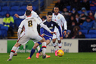 Cardiff City's Tom Lawrence (blue) takes on M K Dons Darren Potter (8). Skybet football league championship match, Cardiff city v MK Dons at the Cardiff city stadium in Cardiff, South Wales on Saturday 6th February 2016.<br /> pic by Carl Robertson, Andrew Orchard sports photography.