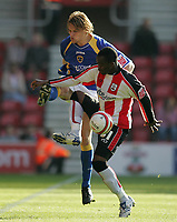 Photo: Lee Earle.<br /> Southampton v Cardiff City. Coca Cola Championship. 21/10/2007. Cardiff's Glenn Loovens (L) battles with Stern John.