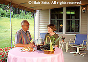 Active Aging Senior Citizens, Retired, Activities, Aged Couples Dine, Dinner at Home Outdoors on Porch, Special Dinners