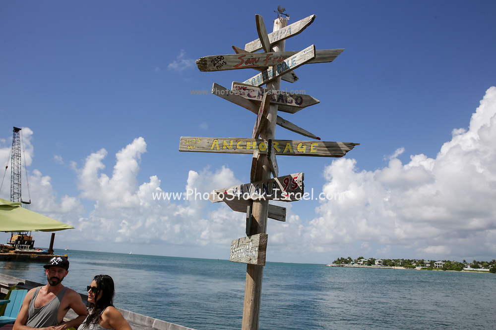 Popular direction and distance [in Miles] signs at the equally popular Sunset Pier Bar on Key West, Florida, USA.