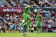 Billy Jones of Sunderland heads clear from Rudy Gestede of Aston Villa. Barclays Premier League match, Aston Villa v Sunderland at Villa Park in Birmingham, Midlands on Saturday 29th August  2015.<br /> pic by Andrew Orchard, Andrew Orchard sports photography.