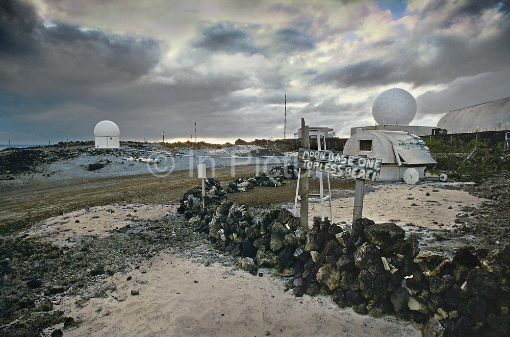 NASA satellie tracking station in comfortless cove, 27th May 1997, on Ascension, a small area of approximately 88 km² isolated volcanic island in the equatorial waters of the South Atlantic Ocean, roughly midway between the horn of South America and Africa. It is governed as part of the British Overseas Territory of Saint Helena, Ascension and Tristan da Cunha. Organised settlement of Ascension Island began in 1815, when the British garrisoned it as a precaution after imprisoning Napoleon I on Saint Helena. In January 2016 the UK Government announced that an area around Ascension Island was to become a huge marine reserve, to protect its varied and unique ecosystem, including some of the largest marlin in the world, large populations of green turtle, and the islands own species of frigate bird. With an area of 234,291 square kilometres 90,460 sq mi, slightly more than half of the reserve will be closed to fishing.