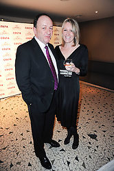 Managing Director of Costa JOHN DERKACH and his wife LYNNE at the Costa Book Awards 2009 held at Quaglino's, 16 Bury Street, London SW1 on 26th January 2010.