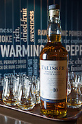 75cl bottle of 10 year old Talisker single malt Scotch Whisky and dram glasses for tasting (dramming) on visitors tour at the Distillery, Isle of Skye, Scotland