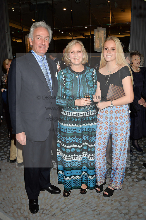 NICHOLAS & ALEXANDRA WILLIAMS and their daughter GUSTY WILLIAMS at a party to celebrate the publication of Thenford: The Creation of an English Garden by Michael & Anne Heseltine held at The Grosvenor House Hotel, Park Lane, London on 24th October 2016.