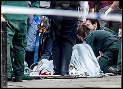 March 22, 2017 - London, United Kingdom - Victims being attended to at the scene of a suspected terror attack at the Houses of Parliament.  (Credit Image: © Pete Maclaine/i-Images via ZUMA Press)