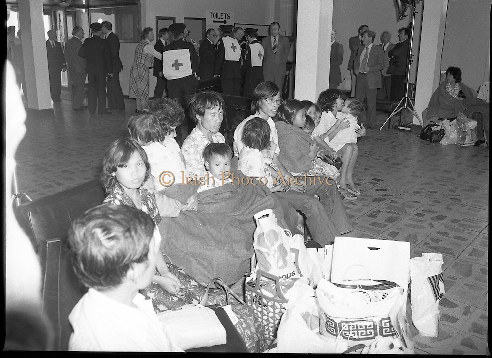 Vietnamese Refugees Arrive In Ireland.   (M85)..1979..09.08.1979..08.09.1979..9th August 1979..As part of an UNHCR initiative, Ireland agreed to take some of the Vietnamese (boat people) refugees into the country. A temporary refugee centre has been set up in the grounds of Blanchardstown Hospital to accomodate the families, from where they will be assimilated into the community..Picture shows the refugees taking a breather in the Airport Custom hall as the wait for transportation to the temporary centre in Blanchardstown Hospital.