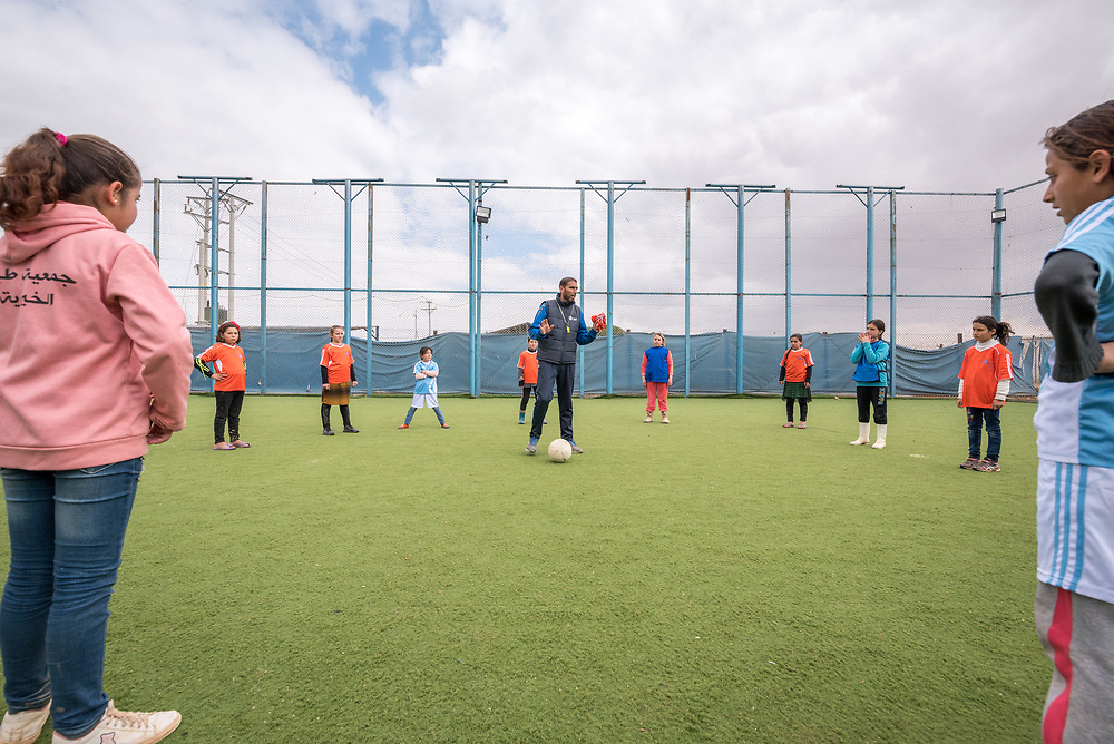 20 February 2020, Za'atari Camp, Jordan: The coach gives instructions during football practice for girls in the Peace Oasis, a Lutheran World Federation space in the Za'atari Camp where Syrian refugees are offered a variety of activities on psychosocial support, including counselling, life skills trainings and other activities.