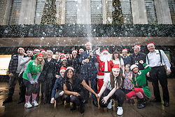 © Licensed to London News Pictures . 01/12/2018. Manchester , UK . Staff open champagne in front of the Kendal's House of Fraser department store on Deansgate in Manchester City Centre after a new rental agreement was secured with the landlord , securing 560 jobs . Photo credit : Joel Goodman/LNP