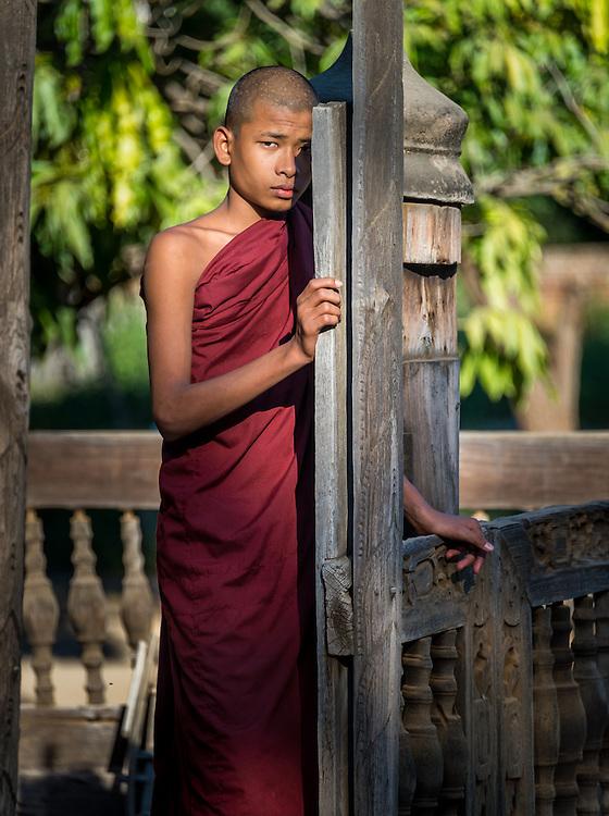 BAGAN, MYANMAR - CIRCA DECEMBER 2013: Young monk in the village of Shwe Kun Cha Hpaya close to Bagan in Myanmar.