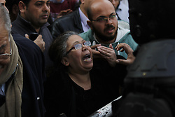 December 11, 2016 - Cairo, Egypt - Christians rally in the street outside the church of St Peter and St Paul in the Coptic Cathedral complex on December 11, 2016 in Cairo, Egypt. At least 25 people were killed and dozens injured after an explosion near the church. ..The blast at Egypt's main Coptic Christian cathedral killed dozens of people and wounded many others on Sunday, according to Egyptian state television, making it one of the deadliest attacks carried out against the religious minority in recent memory. (Credit Image: © Fayed El-Geziry/NurPhoto via ZUMA Press)