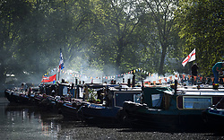 © Licensed to London News Pictures. 04/05/2019. London, UK. Canalway Cavalcade festival takes place in Little Venice, West London on Saturday, May 4th 2019. Inland Waterways Association's annual gathering of canal boats brings around 130 decorated boats together in Little Venice's canals on May bank holiday weekend. Photo credit: Ben Cawthra/LNP